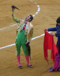 bullfighter drinking from a bota